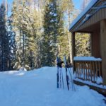 snow outside cabin with skis and poles | the DAWN Method