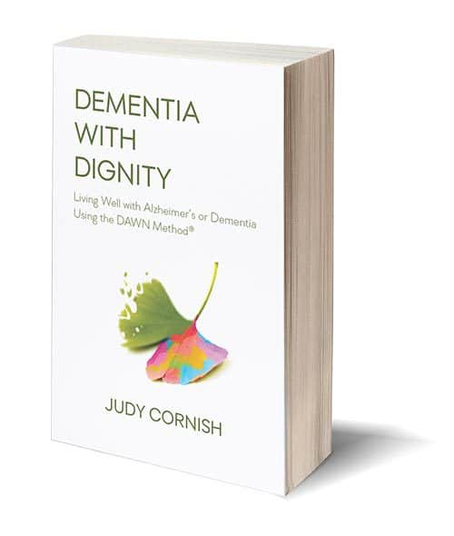 Book: Dementia with Dignity: Living Well with Alzheimers and Dementia Using the DAWN Method® by Judy Cornish (ginkgo leaf on cover with one half fading and the other becoming rainbow colored)